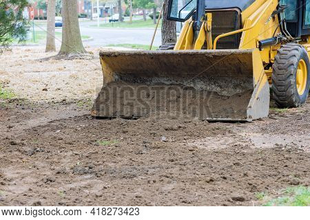 Bulldozer Moving, Leveling Ground At Construction Site In Ground Using Shovels