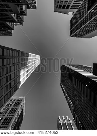 Clear Sky Over Skyscrapers In Nyc, From An Upward Perspective On A Sunny Day. The Focus Is On The Cl