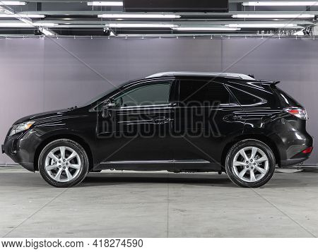 Novosibirsk, Russia - April 25 2021: Black Lexus Rx, Side View. Photography Of A Modern Car On A Par