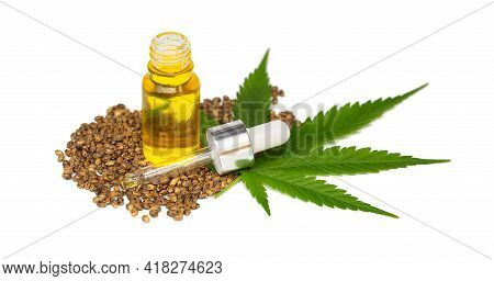 Hemp Oil In A Glass Jar Isolated On A White Background, Pure Cold Pressed Oils Concept, Cbd Hemp Oil
