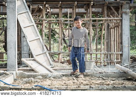 Children Working At Construction Site For World Day Against Child Labor Concept, Poverty, Human Traf