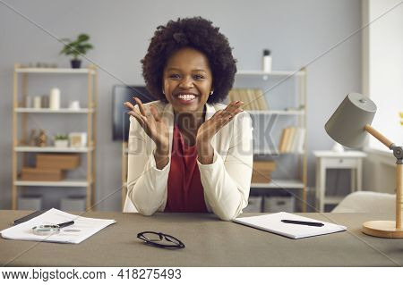 Happily Smiling Satisfied African American Woman At Table In Office Portrait