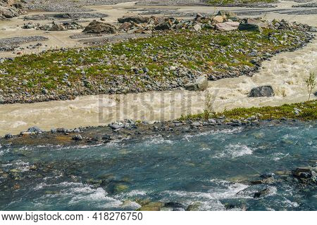 Sunny Alpine Landscape With Confluence Of Two Various Mountain Rivers. Beautiful Clear Creek Flows I