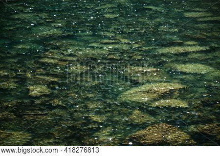 Meditative Ripple And Many Reflected Lights In Green Mountain Lake. Beautiful Relaxing Background Of