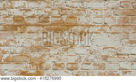 Brick Wall Facade Texture Texture Background. A Textured Background Of Decayed Old Red And White Bri