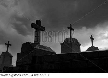 Cemetery Or Graveyard In The Night. Haunted Cemetery. Spooky Burial Ground. Horror Scene Of Graveyar