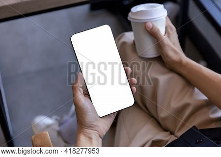 Top View Female Hands Holding Smart Phone With Blank White Screen. Women Hands Workspace, Close-up H