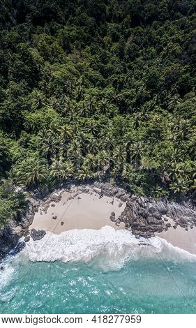 Aerial Drone Top Down View Of Beatiful Beach Blue Sea. Panorama View Of Beach With Coconut Palm Tree