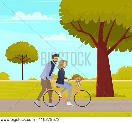 Guy Teaches His Friend To Ride Bike. Man Supports Woman On Bicycle On Happy Date. People Rest In Nat