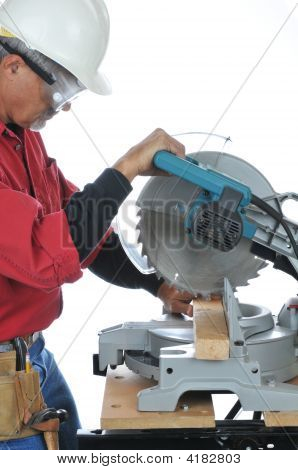 Construction Worker Using Saw