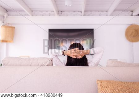 Woman Take Nap While Sitting On Couch In Living Room With Hands Over Head,relaxing Time