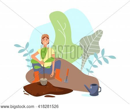 Young Cute Woman Farmer Plants A Tree Sapling In The Ground In The Garden. The Concept Of Gardening,