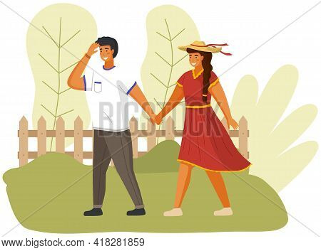 Happy Couple In Love Is Walking In Sunny Day. Smilling Guy Is Walking With Girl In Hat Outdoors. Fre