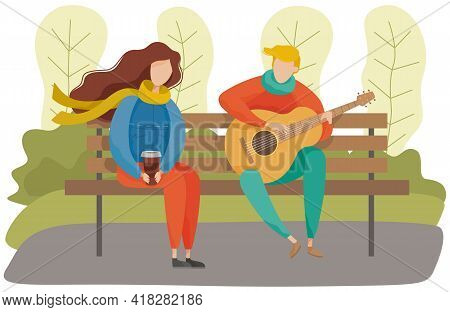 People In Relationship Sitting On Bench In Park. Couple On Date, Man Playing Music On Guitar. Girl H