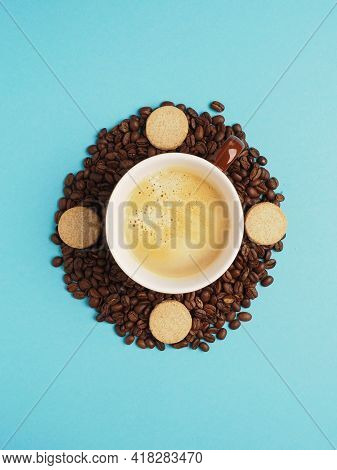 Cup Of Tasty Coffee On Coffee Beans With Cookies Turns Clockwise. Drinking Coffee On A Daily Basis.