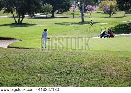 April 21, 2021, Laguna Nigel California USA - Women enjoying Golf on a Golf Course. Editorial Use Only.