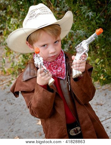Boy Dressing Up As Cowboy