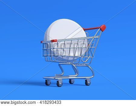 Big White Pill In Shopping Cart On Blue Background. Shopping Trolley With Pill And Capsule. Pharmacy