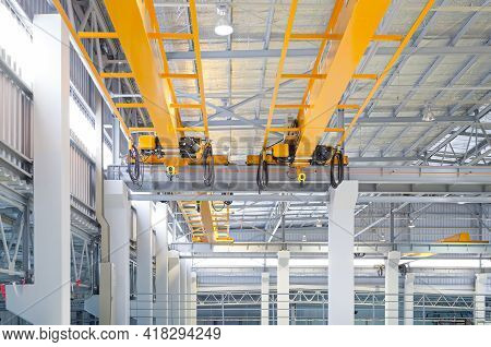 Overhead Crane Inside Factory Or Warehouse. That Industrial Machinery Or Lifting Equipment Consist O