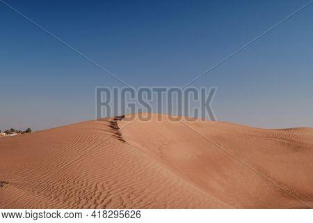 Sunset Over The Sand Dunes In The Desert.