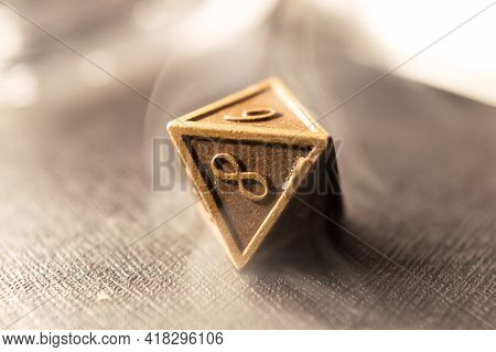 High Contrast Close-up Image Of A 8-sided Role Playing Die Surrounded By Smoke.