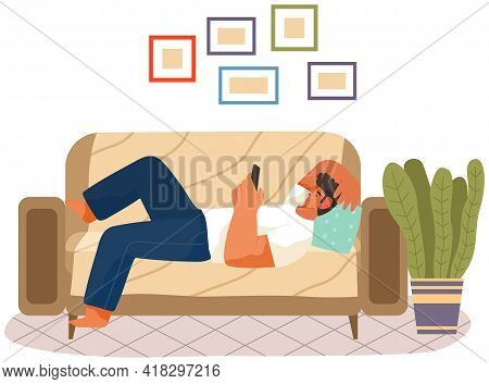 Man Is Lying On Couch And Holding Phone In Hand. Rest, Free Time, Leisure Concept. Guy Looks At Smar