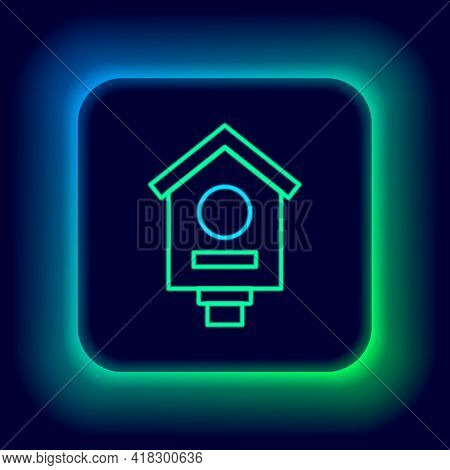 Glowing Neon Line Bird House Icon Isolated On Black Background. Nesting Box Birdhouse, Homemade Buil