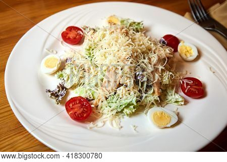 Chicken Breast Salad With Parmesan Cheese, Eggs And Tomatoes. Close-up, Selective Focus