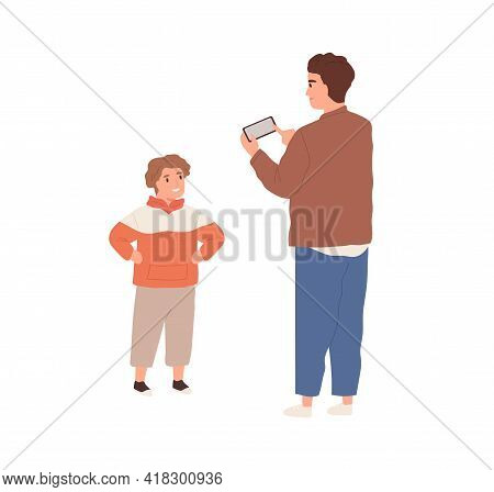 Young Dad Holding Phone And Taking Mobile Photo Of His Child. Little Boy Posing For Fathers Photogra