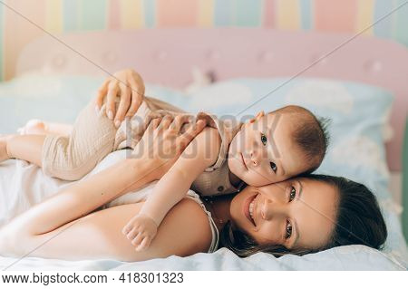 Young Mother Hugs Her Mixed Race Child. Child Adoption And In Vitro Fertilization Ivf . Asian Baby A