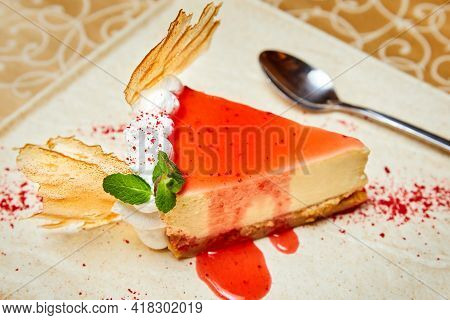 Cheesecake With Caramel Decor And Red Syrup. Close-up, Selective Focus