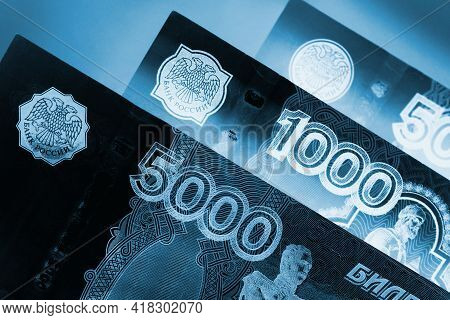 Russian Banknotes 5000, 1000, And 500 Rubles Close Up. Dark Dramatic Black And Blue Illustration Abo