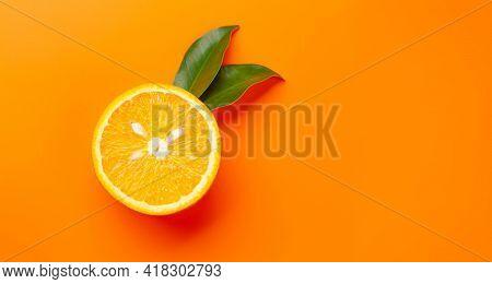 Fresh ripe orange citrus fruit on orange background. Top view flat lay with copy space