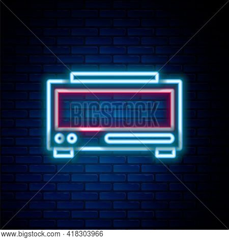 Glowing Neon Line Digital Alarm Clock Icon Isolated On Brick Wall Background. Electronic Watch Alarm