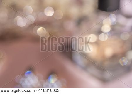 Blurred Background. Luxe Perfume In Beautiful Bottle With Accessory On Toilette Table. Luxury Beauty