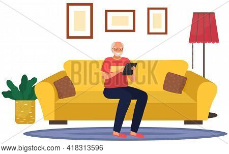Elderly Man Sitting On Couch With Tablet Pc, Working At Home With Electronic Equipment In His Hands.
