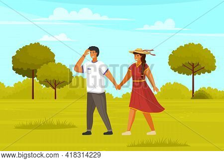 Couple Walking In Park Summertime. Young Guy And Girl Wearing Light Dress And Straw Hat Holding Hand