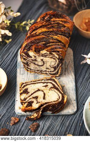 Poppy Seeds Swirl Bread Or Brioche Bread. Homemade Sweet Dessert Pastry