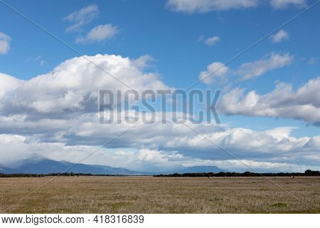 Beautiful clouds over a lonely meadow