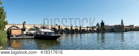 Charles Bridge In Prague With Reflection In Water. Romantic Travel Views Of Prague, Czech Republic,