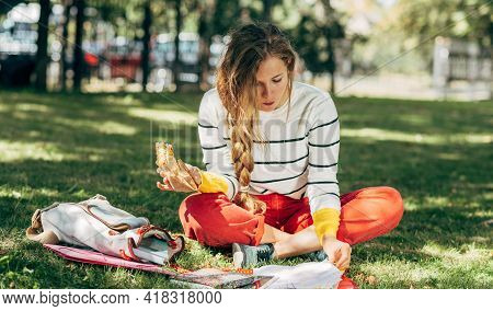 Horizontal Outdoor Student Female Sitting On The Green Grass The College Campus On A Sunny Day, Have