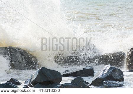 Sea Waves In Bright Sunlight Roll On The Beach. Beautiful Pastel Gray Sea Background. The Concept Of