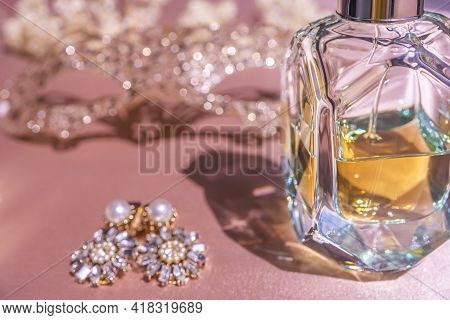 Luxe Perfume In Beautiful Bottle With Accessory On Toilette Table. Selective Focus. Luxury Beauty Br