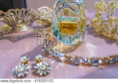 Luxe Perfume In Beautiful Bottle With Hoop With Precious Stone And Accessory On Toilette Table. Sele