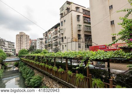 Tucheng District, Taiwan - June 14th, 2020: city ditch with buildings in New Taipei, Taiwan, Asia