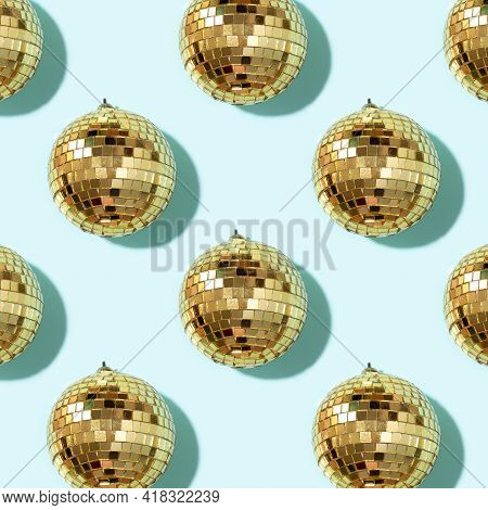 New Year Baubles. Shiny Gold Disco Balls On Blue Background. Pop Disco Style Attributes, Retro Conce