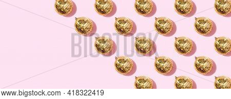 New Year Baubles. Shiny Gold Disco Balls On Pink Background. Pop Disco Style Attributes, Retro Conce