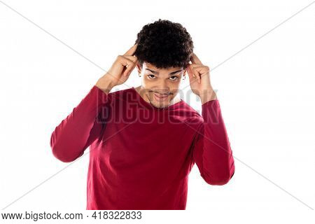 Cute african american man with afro hairstyle wearing a burgundy T-shirt isolated on a white background