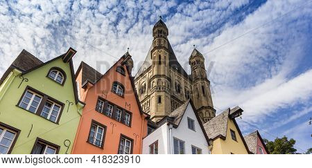 Panorama Of Colorful Old Houses And Church Tower At The Fish Market Square In Koln, Germany
