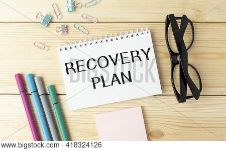 Recovery Plan Inscription, Calculator, Pen And Notebook On Office Desk. Business Concept. Recovering